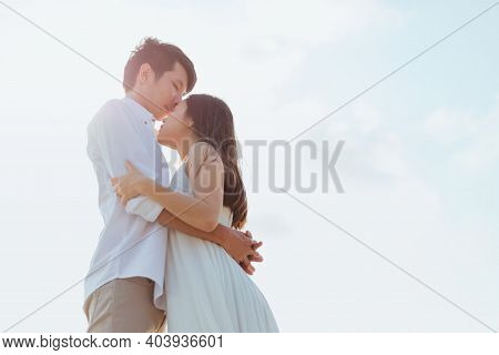 Romantic Time Loving Couple Kissing On The Beach. Love Travel Concept.
