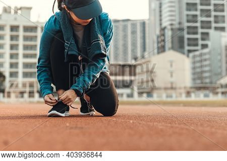Woman Tying Shoe Laces. Woman Fitness Runner Get Ready For Jogging On Way In The City.