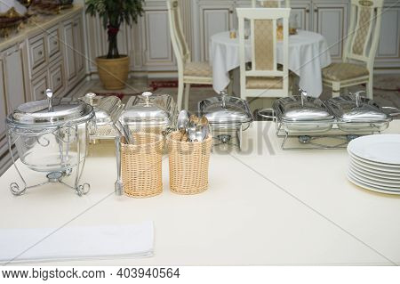 Luxury Tableware And Silverware On A Table In A Dining Room, Interior Shot