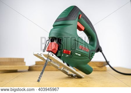 Modern Electric Jig Saw Tool For Diy Home Woodworking. Wood Boards On Background