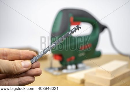 Jigsaw Files For Modern Electric Jig Saw Tool. Diy Home Woodworking. Wood Boards On Background
