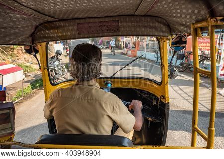 Cochin, India - February 1, 2020: View from the inside of auto rickshaw in Kerala state, India. Tuk tuk ride in India.