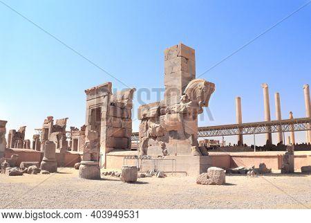 Ancient column with stone statue of bull in Persepolis - capital of the Achaemenid Empire, near to Shiraz, Fars Province, Iran. UNESCO world heritage site
