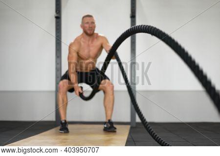 Unfocused Unrecognizable Man Gym Battle Rope Stamina Training Athlete Guy Fitness Exercising Enduran