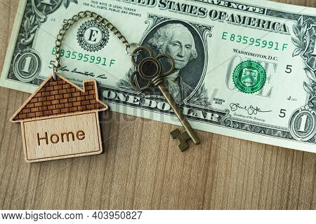Home Key With House Keyring On Dollar Bill Stack, Real Estate Planning Concept