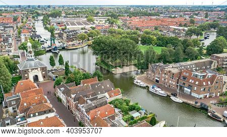 Aerial Drone View Of Leiden Town Cityscape From Above, Typical Dutch City Skyline With Canals And Ho