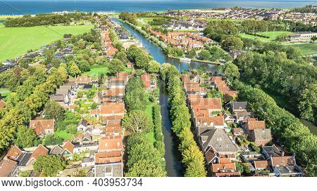 Aerial Drone View Of Edam Town Cityscape From Above, Typical Dutch City Skyline With Canals, Houses