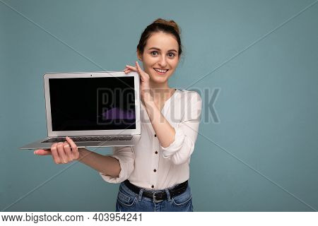 Beautiful Smiling Young Woman Holding Netbook Computer Looking At Camera Wearing White Shirt Isolate