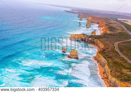 Great Ocean Road. The Twelve Apostles are a group of limestone rocks in the Pacific Ocean near the coast. Australia. Aerial view. Helicopter flight over the scenic Pacific coastline.