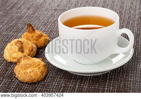 Coconut Cookies, White Cup With Tea On Saucer On Dark Mat