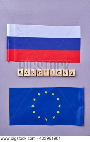 Russian And Eu Flags. Sanctions Concept Vertical Shot.