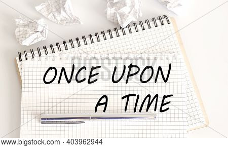 Text On Notepad Once Upon A Time On The White Background. Business Concept