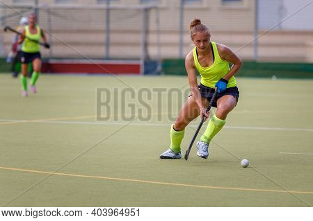 Young Field Hockey Female Player In Attack