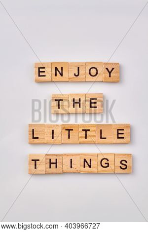 Enjoy The Little Things. Wise Advice For Finding Happiness. Wooden Cubes With Letters Isolated On Wh