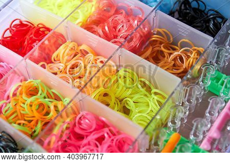 A Set Of Colorful Rubber Bands And Loom Knit For Knitting Wristbands. Close-up, Selective Focus.