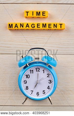 Time Organisation For Personal Efficiency. Clock As A Symbol Of Time On The Wooden Table.