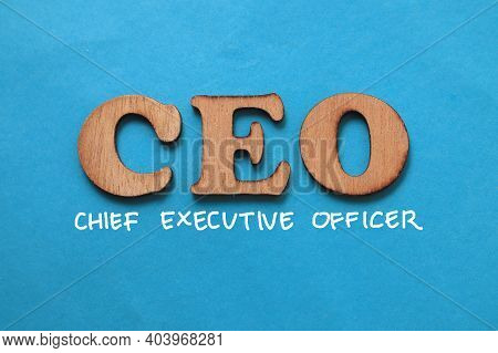 Ceo Chief Executive Officer, Text Words Typography Written On Paper Against Blue Background, Life An