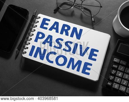 Earn Passive Income, Text Words Typography Written On Book Against Dark Background, Life And Busines