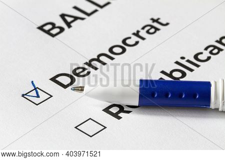 Checklist Concept. Closeup Of Ballot Paper With Words Democrat And Republican And A Pen On It. A Che