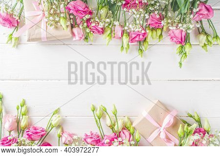 Beautiful Spring Flowers On White Wooden Background. Festive Floral Composition With Craft Paper  Gi