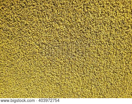Yellow Carpet Roll Covering. Polypropylene Long Pile Carpet Texture Background. Top View