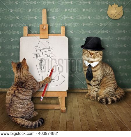 A Beige Cat Artist With A Paintbrush Paints His Friend In A Hat On A Canvas On An Easel In His Art S