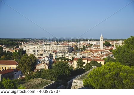 Panoramic View Of Pula Croatia With All Buildings And Green Trees. Istria Territory With Brown Roofs