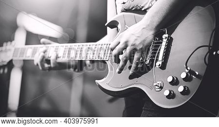 Black And White Image Of Professional Rock Musician Playing On Electric Guitar Punk Rock Concert. Mu