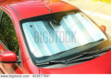 Sun Shade Under Windshield In Car, Closeup. Heat Protection