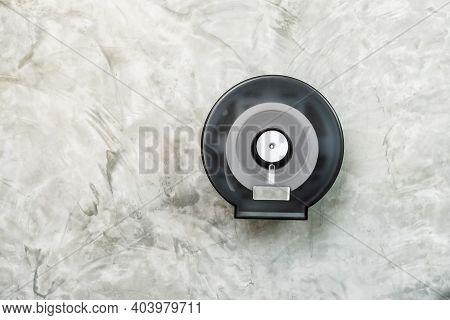 White Tissue Rolls In A Black Circle Plastic Box Hang On A Concrete Loft Wall. Tissue Paper In Boxes