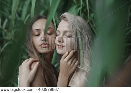 portrait of couple young women under a plant