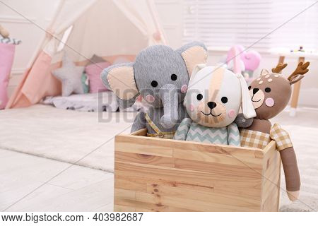 Wooden Crate With Cute Toys In Stylish Playroom, Space For Text. Interior Design