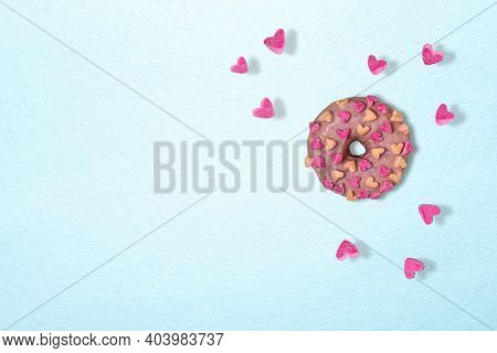 Tasty Glazed Pink Doughnut Decorated With Marshmallow Hearts. Few Hearts Are Flying Around Doughnut.