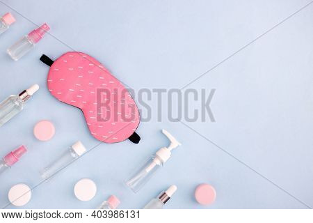 Daily Skin Care Concept. Sleep Mask With Cosmetic Product On Blue Background. Top View, Flat Lay, Co