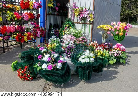 Artificial Flowers And Wreaths For Decorating Graves For Sale Near The Cemetery. Russian Tradition.