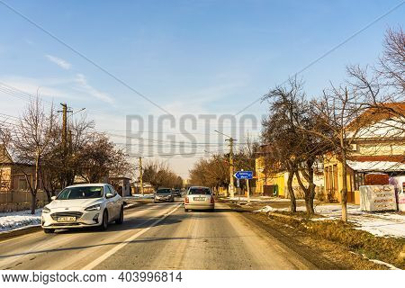 Winter Season, View Of Cars And Snowy Street Through Windshield While Driving In Bucharest, Romania,