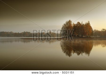 Small island on the water with the trees. poster