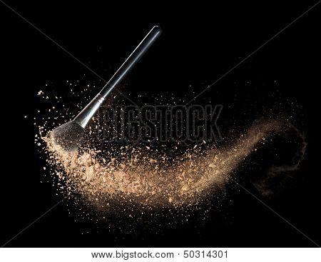 Isolated make-up powder with brush on black background