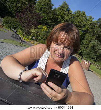 Mature Woman Texting On Mobile