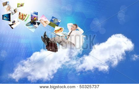 Businessman on the cloud. Internet concept
