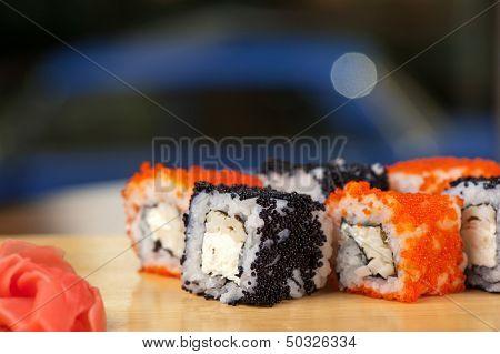 Japanese cuisine - tobico sushi rolls poster