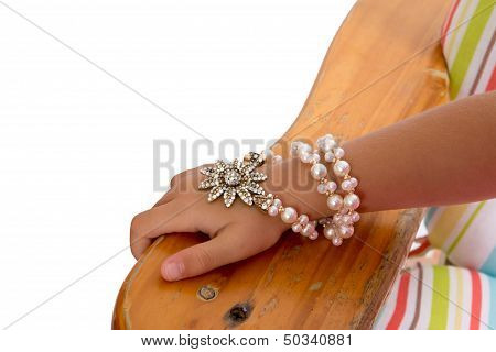 Young Girl Wearing A Pearl And Foral Bracelet