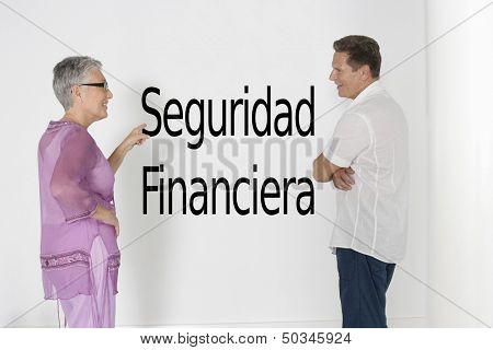Couple discussing financial security against white wall with Spanish text