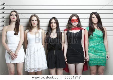 Young woman in superhero costume with friends in a police lineup