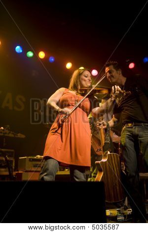 Suzanne Rohrer Strumming Her Fiddle With Chris Hurt Looking On With Approval