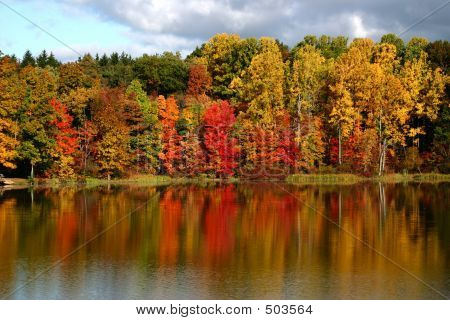 fall colors reflected in a smooth lake poster