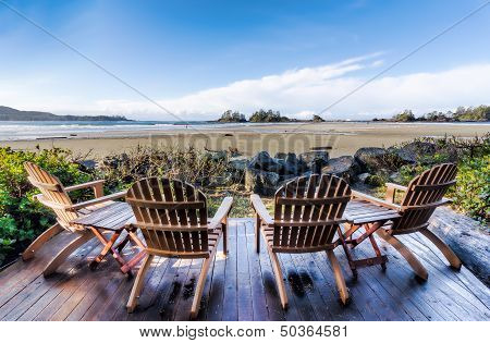 Four Chairs On Deck Overlooking Beach
