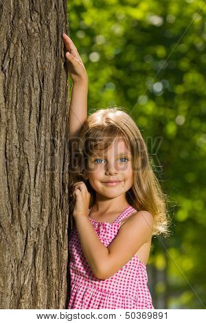 Young Girl Near A Tree