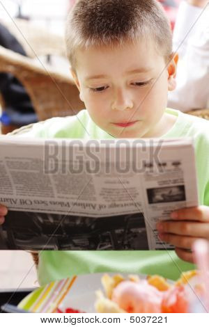 Boy Reading Newspaper