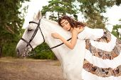 Beautiful woman on a horse. Horseback rider, woman riding horse poster